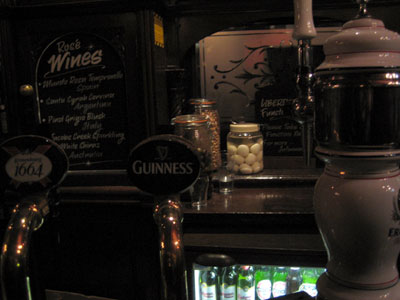 A picture of a bar in a pub that sells pickled eggs